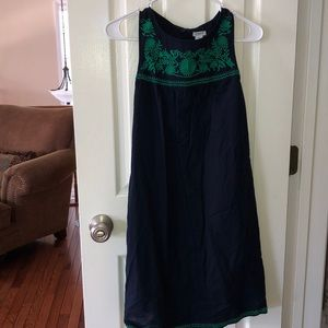 A beautiful blue dress with green detailing